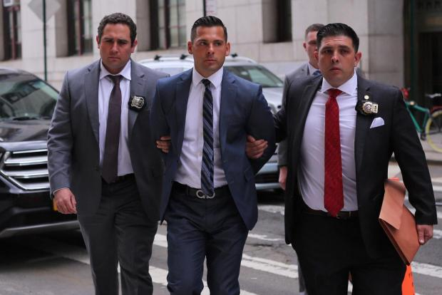 Lawrence Dilione is walked into the Manhattan DAs Office1.jpg