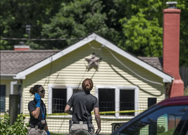 Police investigate the Arnau family's home in Strasburg1.png