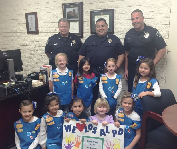 Captain Rick Moore [center] in the Chief's office with Police Chief Eric Nunez [left], and Captain Sean Connolly [right], during a tour by the Daisy Girl Scout Troop 4271 .jpg