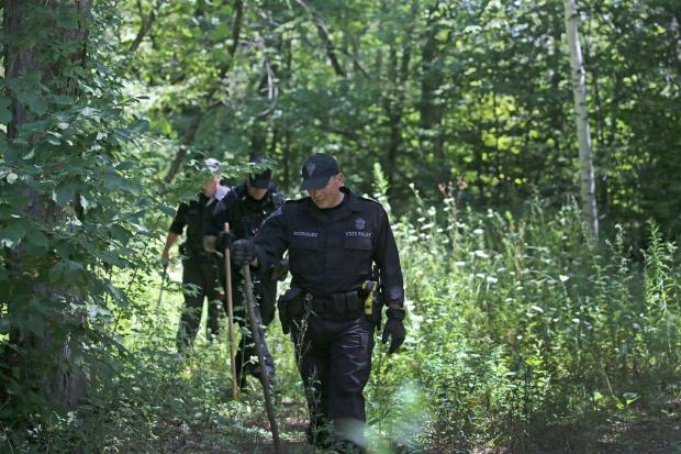 Massachusetts State Police search the woods for evidence after Vanessa Marcotte's body was found in August. 2016