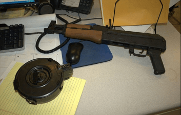 The AK-47 and its high-capacity drum magazine which officer Jason Stockley put it there after shooting Anthony Lamar Smith