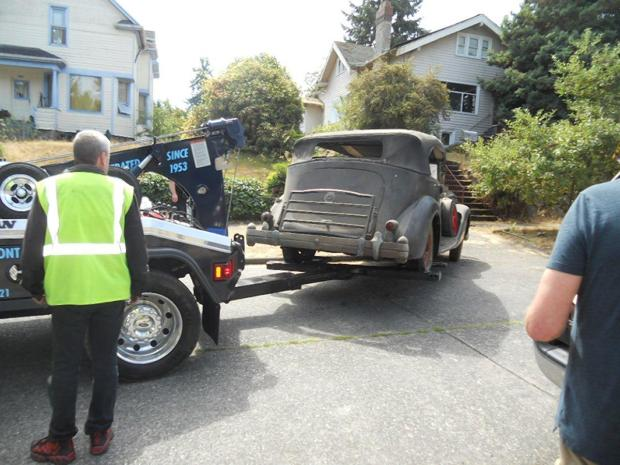 A Packard is taken away from the Emery brother's home .jpg