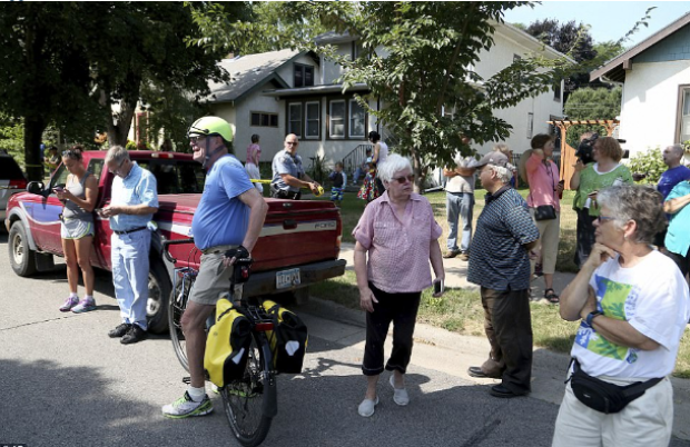 Minihaha High School Gas Explosion - Locals gathered at the scene of the explosion.png