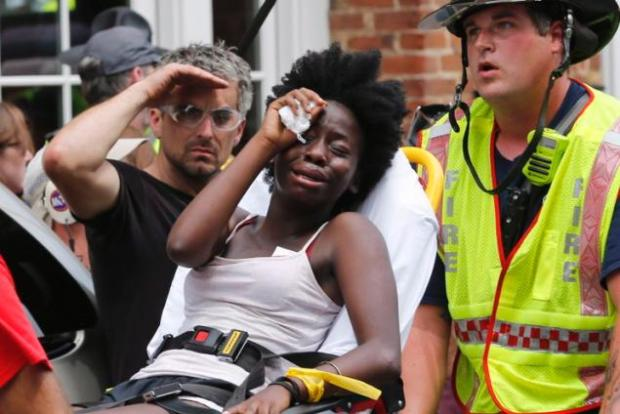 Protesters injured as a car purposefully mows down the crowd following 'Unite the Right' rally.jpg