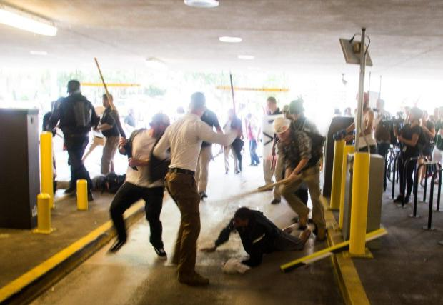 White supremacists beating Deandre Harris in Charlottesville on Saturday.jpg