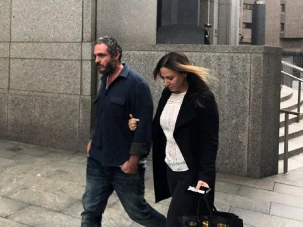 Joseph Meli and his wife, Jessica Meli, exit U.S. Federal Court in Manhattan
