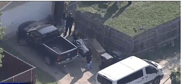 Police remove body of mass shooting victim in Plano Tex, Sept 10, 2017.png