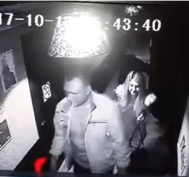 CCTV screen capture of Daria Labutina and Olga Shaposhnikova leaving the club with Alexandr Maslennikov 1.png