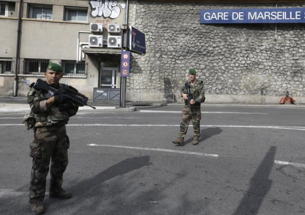 French security officers patrol the Marseille railway station after the stabbing incident Sunday