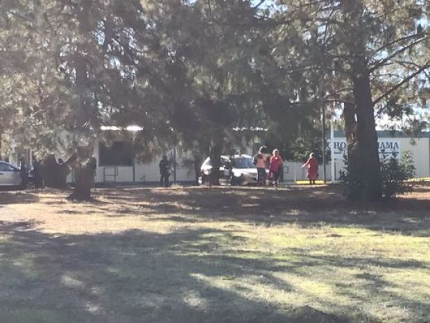 People react at the Rancho Tehama school after he shooting on Tuesday