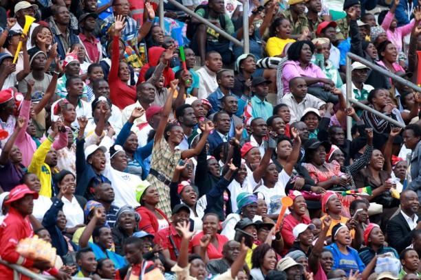 Thousands cheer as Emmerson Mnangagwa arrives at Harare's national stadium with his wife Auxilia, before he takes the oath of office.jpg