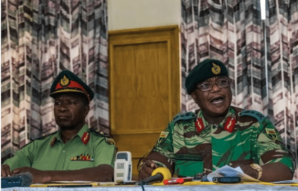 Zimbabwe Army chief Constantino Chiwenga (right) addresses a media conference in Harare on Monday.png
