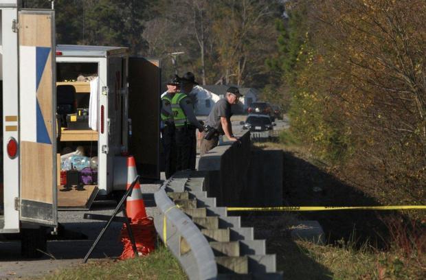 Invesstigators search near the Southwest Creek Bridge for three-year-old Mariah Woods in Jacksonville, N.C., Friday morning.jpg