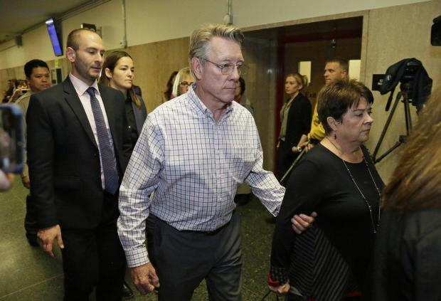 Jim Steinle, center, and Liz Sullivan, right, the parents of Kate Steinle.jpg