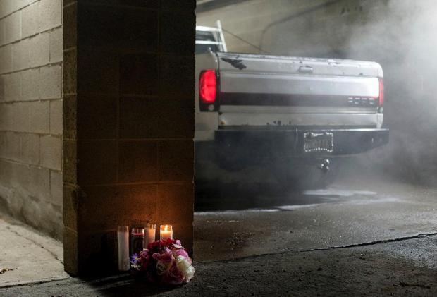 A memorial is seen at Ed's Car Wash .jpg