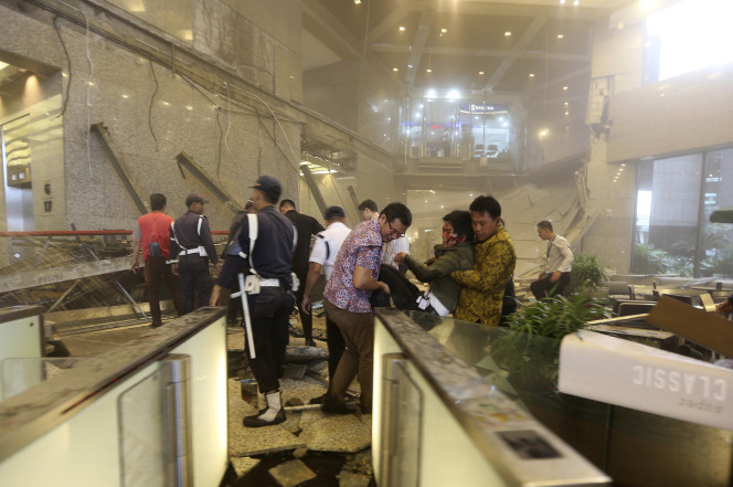 Floor collapses during lunch hour inside Indonesia stock exchange, injuring 80