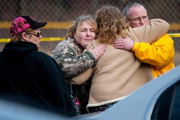 Shocked locals comfort each other at the scene in Saltlick Township on Sunday.jpg