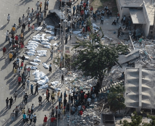 Aerial of survivors gathered around bodies in Port-au-Prince, Haiti during an aerial assessment mission following a day after the earthquake hit in 2010.png
