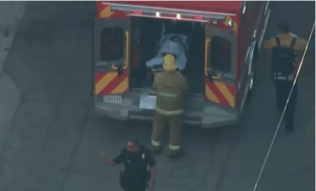 Injured student is transported to hospital.png