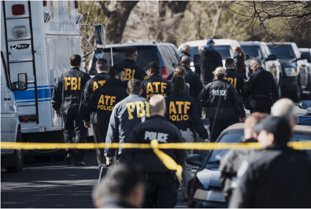 Authorities work on the scene of an explosion in Austin, Texas on  March 12.png