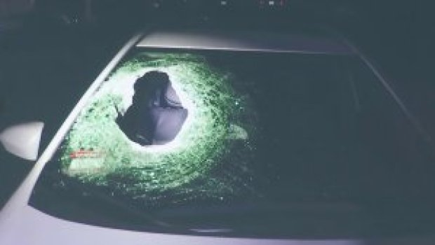 The boulder went through the passenger-side windshield, Cris Lopez who was sitting in the front seat.jpg