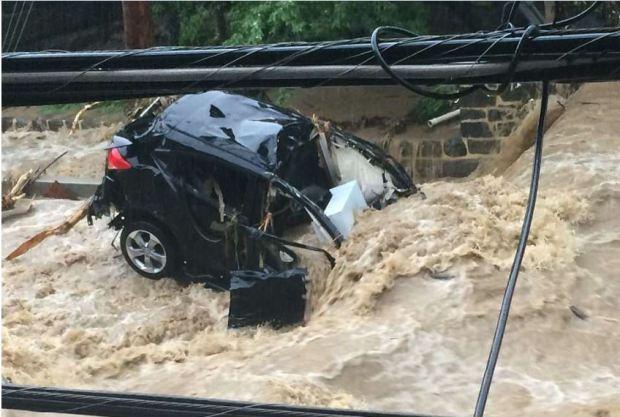 Flood water smashes cars on Ellicott City's Main Street 2.JPG