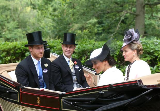 Meghan and Harry rode with Prince Edward and the Countess of Wessex during the traditional carriage procession 2.png