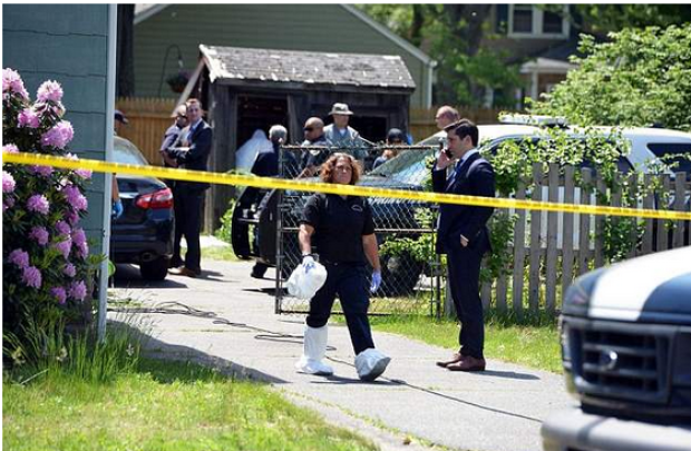 Officers remove bagged evidence from Stewart Weldon's house