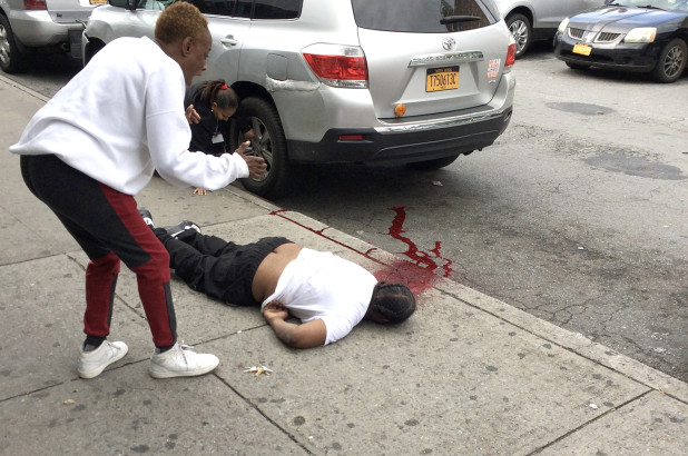 Witness calls for help as Bronx shooting victim bleeds out on the street.jpg