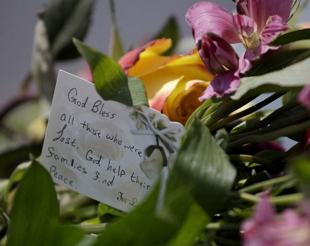 Flowers and notes left by mourners 2.JPG