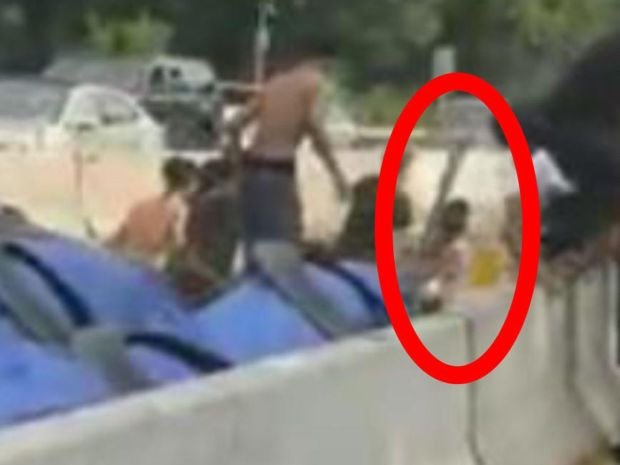 Ramon Paulino, seen beating a 14-year-old victim with a wooden log (circled) in the median of the Bronx River Parkway.jpg