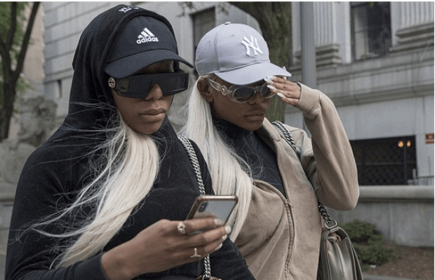 Shannade Clermont [right], steps out of court with her twin sister Shannon  Clermont [left] 6.png