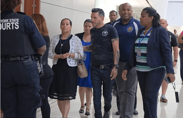 Victim's parents Leandra Guzman (in a white jacket) is guided by Lesandro Feliz father  as they arrive in court on Monday for pre-indictment hearing.png