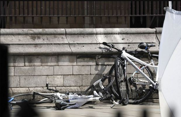 Bicycles are sat against a wall near the scene of the crash at the Houses of Parliament.JPG