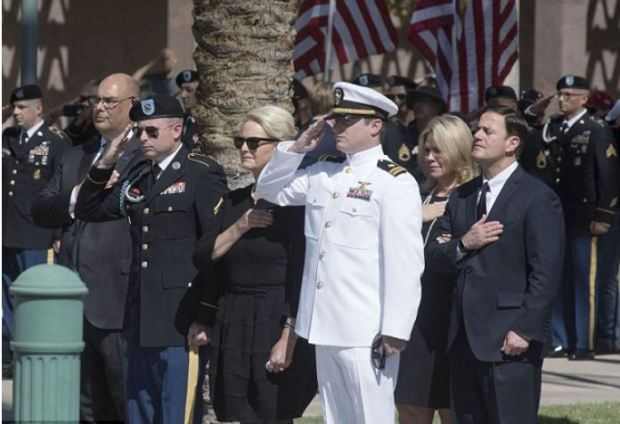 Jimmy McCain and Jack McCain salute their father's coffin 1.JPG