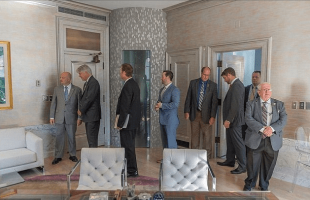 Members of the state House Judiciary Committee inspect offices of the West Virginia Supreme Court justices .png