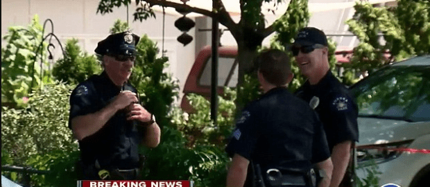 Officers were seen smiling and chatting at the scene where a fellow cop shot dead Black