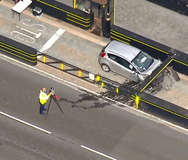 car was stopped in its tracks by a new security barrier.jpg