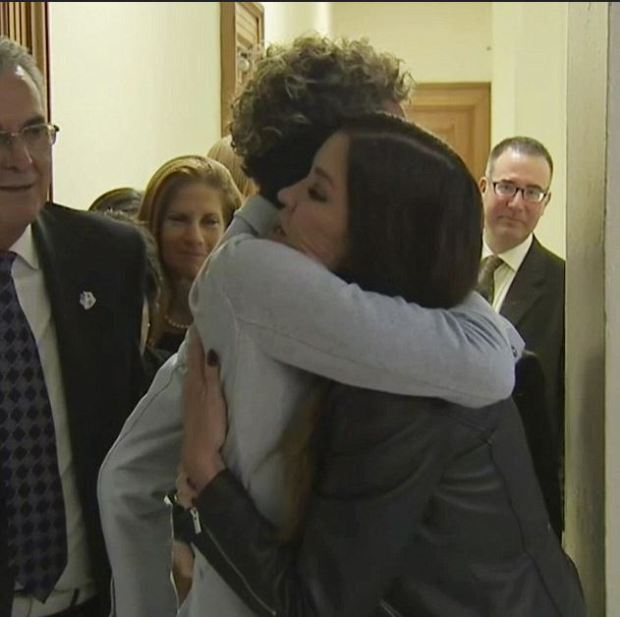 Andrea Constand embraces fellow Cosby accuser Janice Dickinson 1.JPG