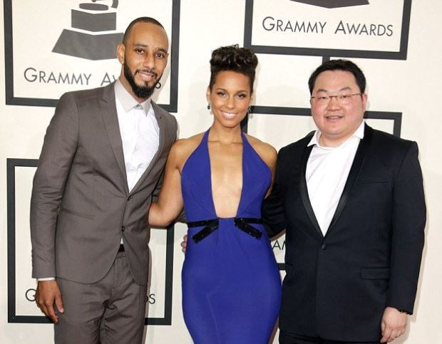 Jho Low seen [right] with singer Alicia Keys [center] and her husband, Swizz Beatz, [left] 1