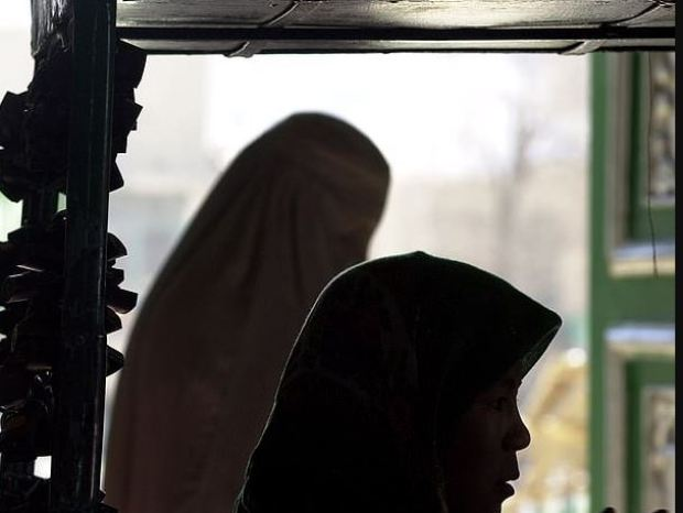 Married woman is arrested in Afghanistan for 'appearing in sex tapes with a Mullah' 1.JPG