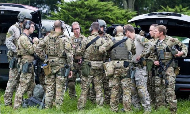 tactical agents confer before moving after female shooter struck in Aberdeen MD