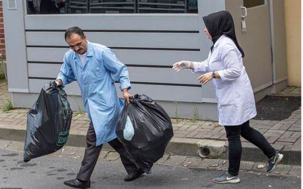 Cleaning crew take out trash rom  the residence of Saudi Arabia's Consul General Mohammad al-Otaibi in Istanbul. Oct 17 2018 before Turkish forensic team arrive 2.JPG