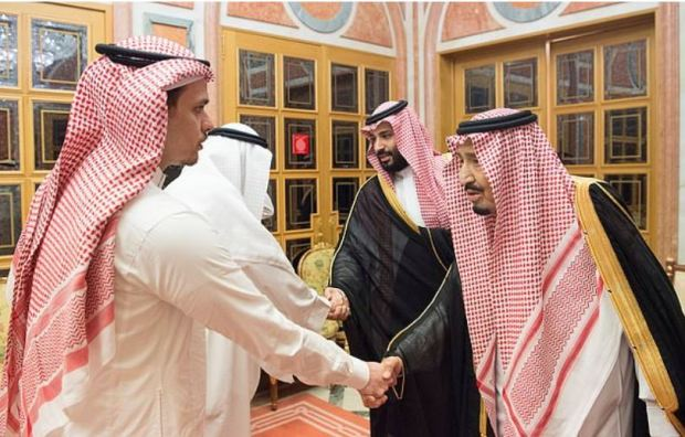 King Salman [right], shaking hands with Jamal Khashoggi's son and. The Crown Prince Mohammed Salman shaking hands with another man.JPG