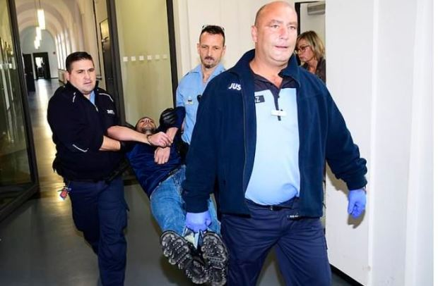 Rami A is dragged intto court for his court appearance in Dresden, Germany 1