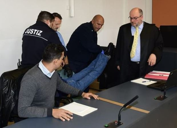 Rami A is dragged intto court for his court appearance in Dresden, Germany 2.JPG