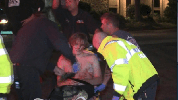 EMTs help the injured in Ian Long shooting 3