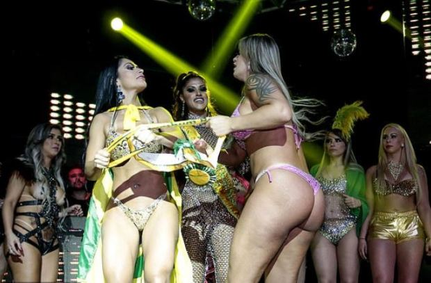 Ellen Santana, [left], tries clinging to her winner's sash as Aline Uva, [right] tries to grab it 1.JPG