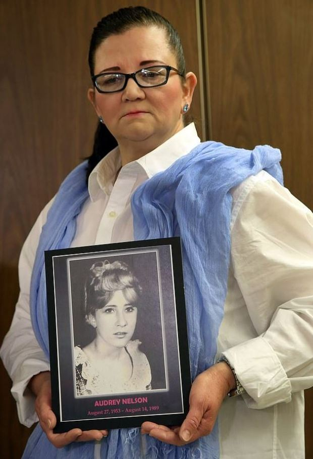 Sherri Nelson holds a picture of her late sister, Audrey Nelson 1.JPG