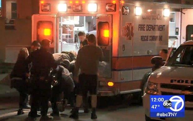 Threesa kiel being loaded into ambulance by EMTs 1.jpg